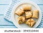 sweet baklava dessert on plate | Shutterstock . vector #394510444