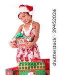 cute asian girl holding a christmas gift - stock photo