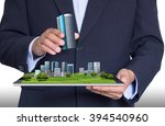 businessman put in a building... | Shutterstock . vector #394540960