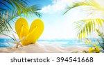 flip flops and starfish on beach | Shutterstock . vector #394541668