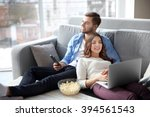 young man watching tv and woman ... | Shutterstock . vector #394561543
