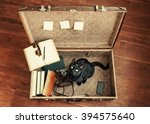 Stock photo large suitcase set of hipster student traveler books retro camera cell phone sunglasses 394575640