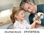 daddy with little girl petting... | Shutterstock . vector #394589836