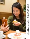 woman take photo with her food... | Shutterstock . vector #394646563