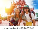 tourists posing in front of... | Shutterstock . vector #394669240