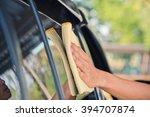 hand with yellow microfiber... | Shutterstock . vector #394707874