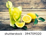 cold lemonade with ice  | Shutterstock . vector #394709320