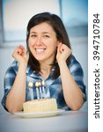 young female with birthday cake ... | Shutterstock . vector #394710784