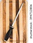 sharpening steel on wooden... | Shutterstock . vector #394712806