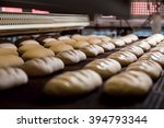 dessert bread baking in  oven.... | Shutterstock . vector #394793344