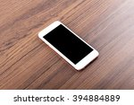 mobile phone on wooden table... | Shutterstock . vector #394884889