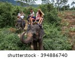 young tourists are riding on... | Shutterstock . vector #394886740