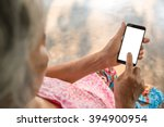 woman elderly using a smart... | Shutterstock . vector #394900954