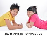 brother and sister lying on.... | Shutterstock . vector #394918723