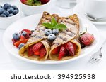 crepes with fresh berries and... | Shutterstock . vector #394925938