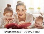 happy loving family. pretty... | Shutterstock . vector #394927480