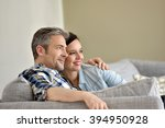 middle aged couple relaxing in... | Shutterstock . vector #394950928