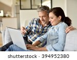 couple in sofa websurfing and... | Shutterstock . vector #394952380