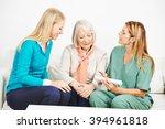 Small photo of Nurse explaining medicine dosage for senior woman at home