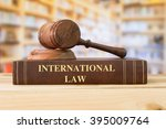 Small photo of International law book with a judges gavel on desk in the library. Sharing agreement applicable to international relations, legal education concept