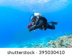 scuba diver floating over coral ... | Shutterstock . vector #395030410