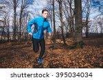 man running in forest | Shutterstock . vector #395034034