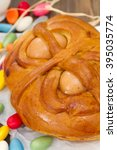 Small photo of portuguese traditional Easter cake Folar on brown wooden background