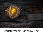 Golden Egg In A Nest On Dark...