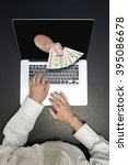 getting money from laptop... | Shutterstock . vector #395086678