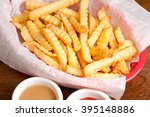 crispy crinkle cut french fries ... | Shutterstock . vector #395148886