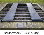 Small photo of EDINBURGH, SCOTLAND - MARCH 11TH 2016: A mortsafe cage covering a grave in Greyfriars Cemetery in Edinburgh, on 11th March 2016. Mortsafes were used to prevent bodysnatchers from stealing corpes.