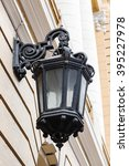old street lamp on the wall of... | Shutterstock . vector #395227978