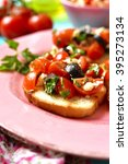 crostini with tomatoes feta and ... | Shutterstock . vector #395273134