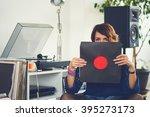 Woman Listening Vinyl At Home