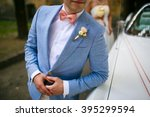 groom in a blue coat with pink... | Shutterstock . vector #395299594