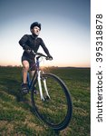 a young male riding a mountain... | Shutterstock . vector #395318878