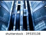 Lifts in modern interior in blue - stock photo