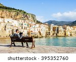 couple sitting on bench ...   Shutterstock . vector #395352760