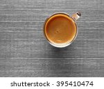 cup of hot espresso coffee on... | Shutterstock . vector #395410474