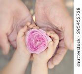 kid and father holding flower... | Shutterstock . vector #395452738
