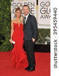 Small photo of LOS ANGELES, CA - JANUARY 12, 2014: Aaron Paul & Lauren Parsekian at the 71st Annual Golden Globe Awards at the Beverly Hilton Hotel.
