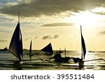 sails at sunset boracay... | Shutterstock . vector #395511484