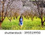 girl in blossoms tree valley... | Shutterstock . vector #395519950