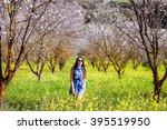 girl in blossoms tree valley... | Shutterstock . vector #395519950