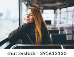 young woman riding in public... | Shutterstock . vector #395613130