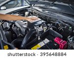worker man open the car hood... | Shutterstock . vector #395648884