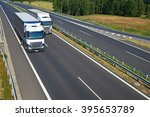 two overtaking the white trucks ... | Shutterstock . vector #395653789