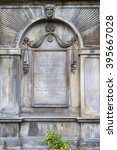 Small photo of EDINBURGH, SCOTLAND - MARCH 12TH 2016: The grave of famous Scotsman Adam Smith at Canongate Kirkyard in Edinburgh, on 12th March 2016.