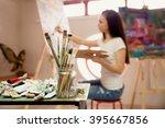 Female Artist Working On...