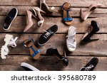 different female shoes on floor.... | Shutterstock . vector #395680789